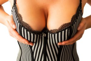 Busty woman's cleavage in a black and white striped top