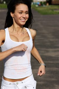 Girl Running With Breast Implants