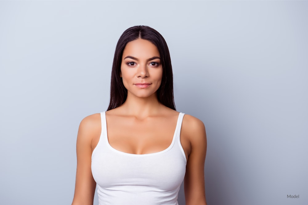 Woman after a cosmetic breast surgery.