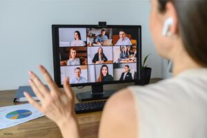 Woman on a videoconferencing call, looking at participants.